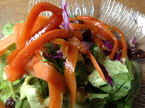 House salad with sauteed carrots and raisins